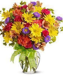 Make their day special with a pretty bouquet of mixed, long lasting flowers!