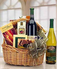 This custom designed basket features red or white wine accompanied by an assortment of fine gourmet foods.
