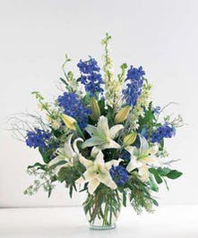 A stunning, fragrant design of lilies & delphinium