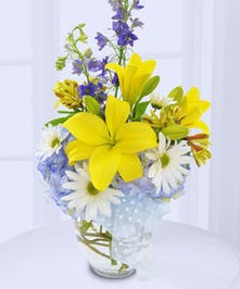 Celebrate a new baby boy with this lovely vase of seasonal flowers!