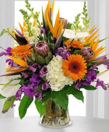 Every bloom will have you saying WOW in this beautiful arrangement