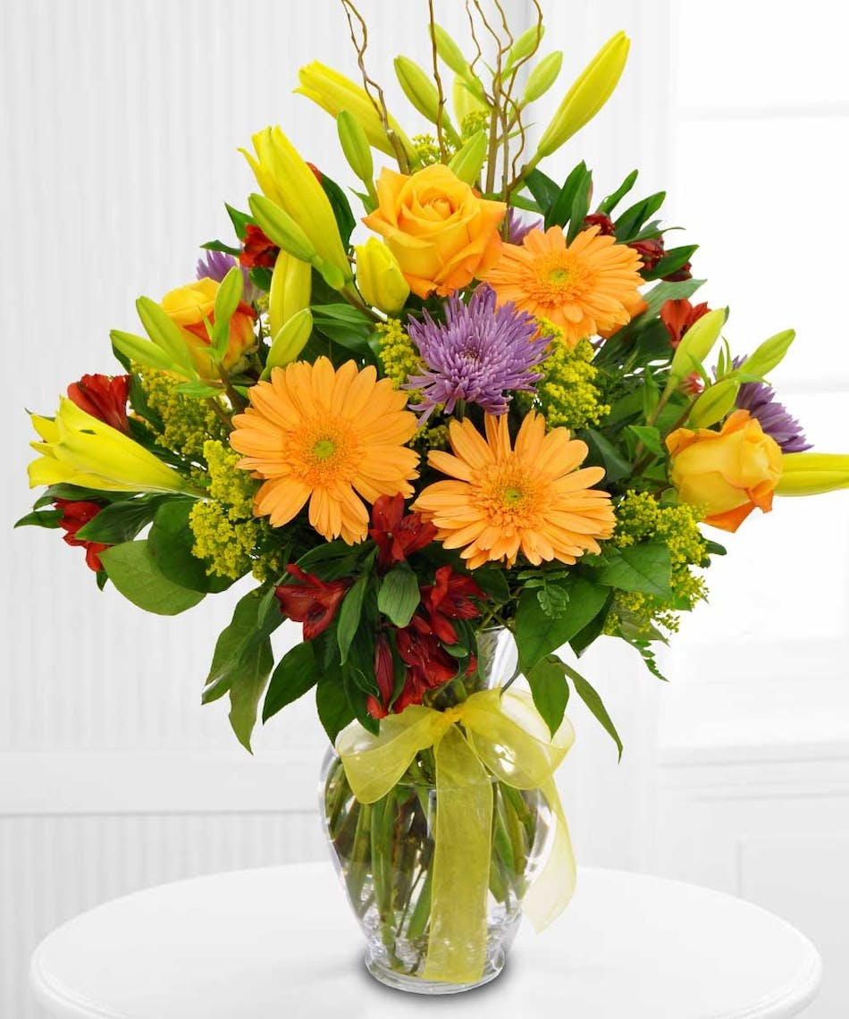 Flowers for every holiday celebration sarasota florist a sunny splendor bouquet izmirmasajfo Image collections
