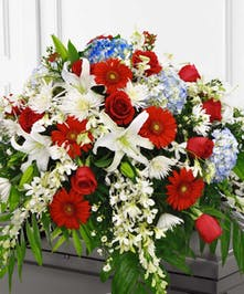 Honor your loved one with this patriotic casket spray.