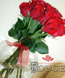 Deeply hued romantic roses designed in unique fashion in a bowl. Select your desired color during checkout!