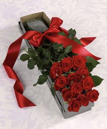 For an elegant display of a classic gift, consider sending a dozen boxed roses!