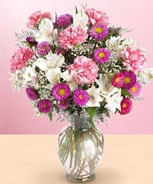 Give a new mom and baby girl this lovely bouquet of pink!
