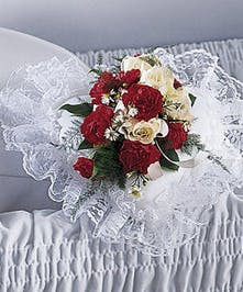 A traditional floral casket pillow design