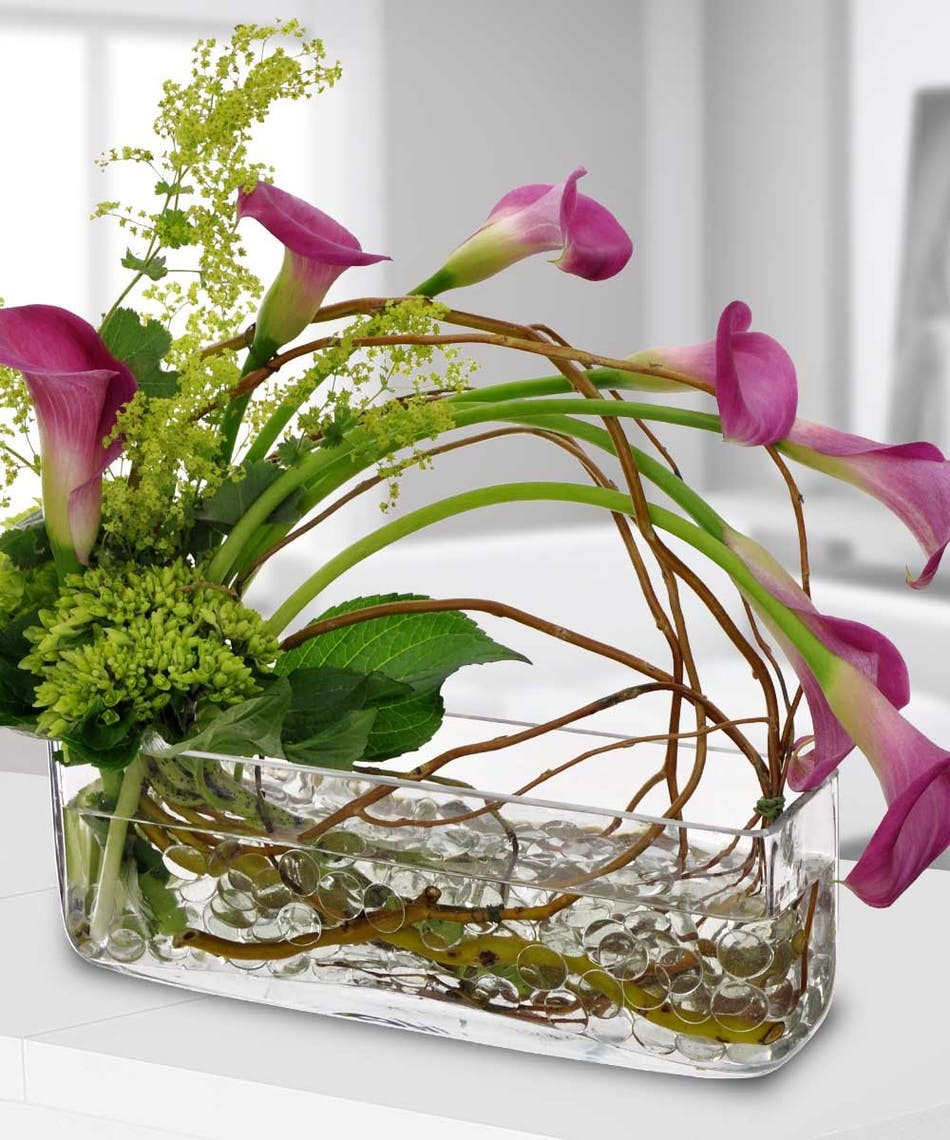 Calla lily cascade calla lilies luxury beneva flowers sleek and elegant pink calla lilies are cascading over this rectangular vase filled with gem stones izmirmasajfo