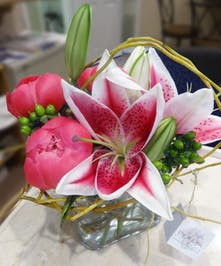 Lovely pink Peonies & Stargazer Lilies create a burst of fragrance.