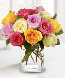 Beautiful roses in lovely pastel colors arranged in a rectangular glass vase will make an impression they won't soon forget!