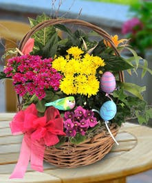 This traditional Easter garden basket is bursting with flowering plants, and is even accented with a bird and Easter eggs!