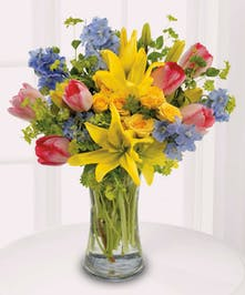 Vibrant, fragrant, and oh-so-lovely, this spring design features lilies, tulips, spray roses, and more!
