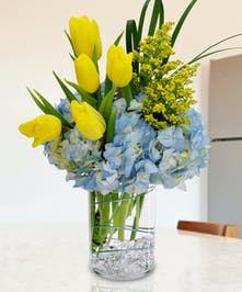 Get into the swing of spring with this stylized bouquet of hydrangea, tulips and more!