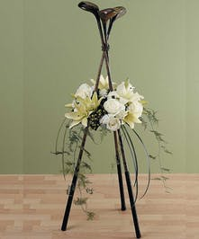 A unique design of white lilies, roses and more centered around his or her activity.