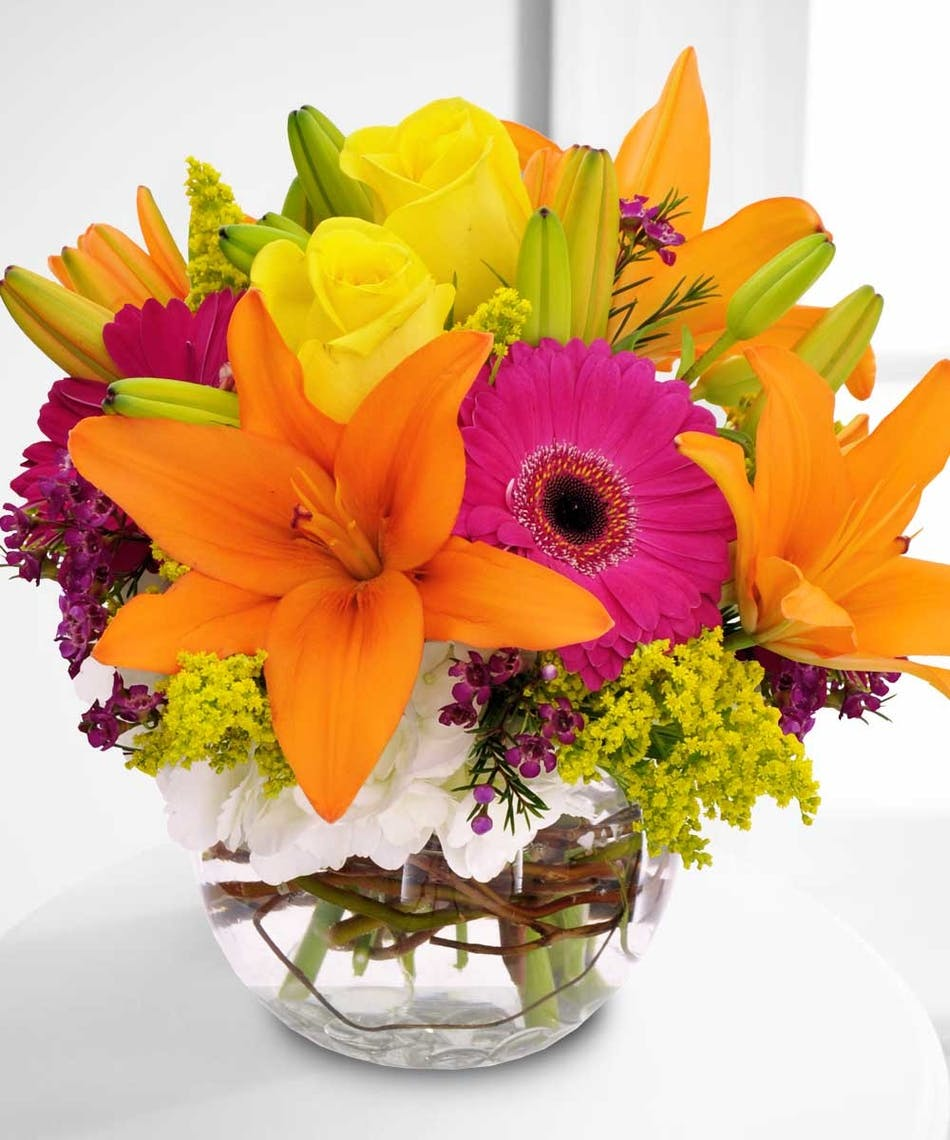 Sunny daze fresh flowers vase calendar beneva flowers this bubble vase filled with orange lilies hot pink gerbera daisies and yellow roses is izmirmasajfo Images