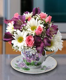 Serve a cup of floral delights, with this long lasting, unique floral design!