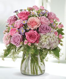This lovely spring favorite captures the beauty of the season, and fills any room with the aroma of roses!