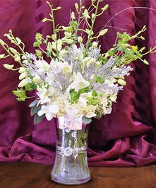 Celebrate in style with a bouquet of white Dendrobium Orchids