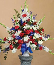 Pay tribute to a true American hero with this red, white and blue floral design.