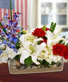 Celebrate in Patriotic Style with this rectangular vase filled with Florida sand and sea shells and mixed flowers