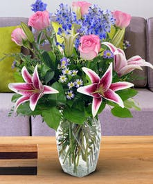 Stunning Stargazers and soft pink roses.