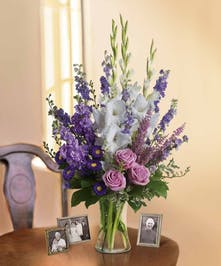 Lavender and white sympathy flowers make a grand statement in this joyful bouquet.