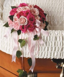Placed inside the casket, this sweet array of pink flowers is a very personal expression of love.