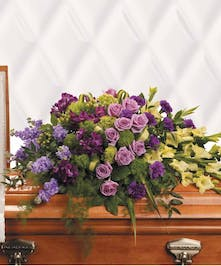 For a life that has been joyfully lived, this opulent arrangement is an expression of gratitude.