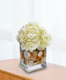 This compact design features Hydrangea in a compact cube.