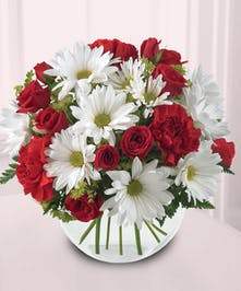 This pretty bouquet features Daisies , Roses & Carnations