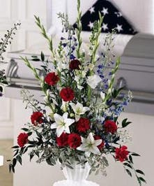 A stylish, classy red, white &blue urn