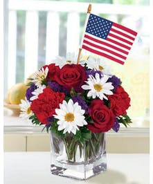 Show you are thinking of someone special on the Holiday. Send them a bouquet of red, white and blue flowers along with a miniature flag.