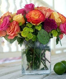 This bright, bold & beautiful design features roses, green pompons