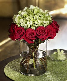 This sophisticated, unique design features stunning red Ecuadorian roses surrounding a cloud of Hydrangea