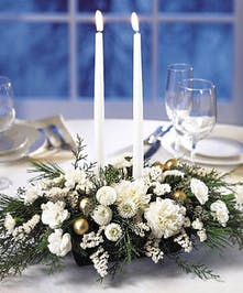 Stunning, all-white centerpiece with taper candles